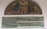 Placa memoriala la intrarea bisericii